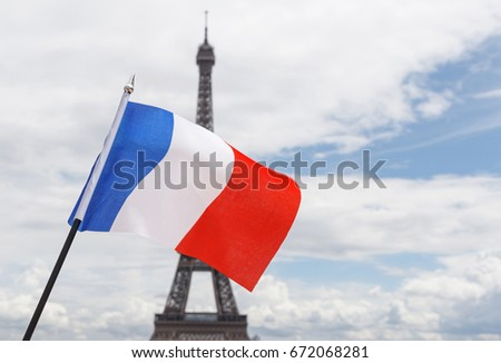 flag of France against Eiffel tower