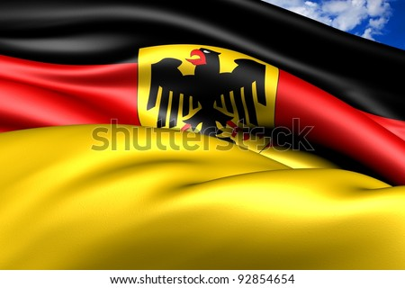 Flag of Germany against cloudy sky. Close up.
