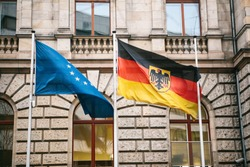 Flag of Germany and the European Union in Berlin. State symbol and national government flag of the Federal Republic of Germany and EU