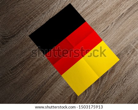 Flag of Germany on paper. Germany Flag on wooden table. #1503175913