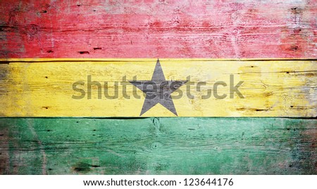Flag of Ghana painted on grungy wood plank background