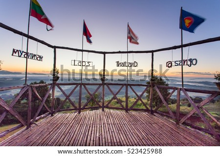 Flag of golden triangle country about Thailand, Laos, Myanmar at the viewpoint of the Golden Triangle at the intersection of the three countries;Thailand, Myanmar, Laos  #523425988