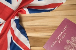 Flag of Great Britain and Polish Passport