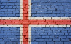 Flag of Iceland painted on brick wall, background texture
