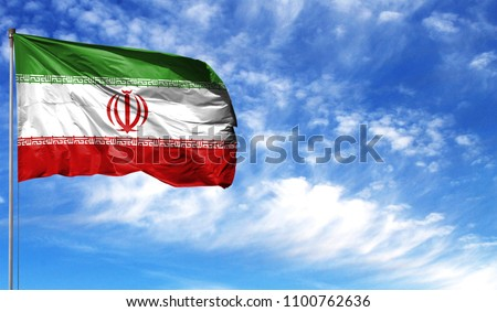 Flag of Iran on flagpole against the blue sky #1100762636