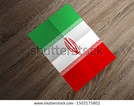 Flag of Iran on paper. Iran Flag on wooden table. #1503175802
