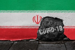 Flag of Iran on the wall with cracked stone with Coronavirus name on it. 2019 - 2020 Novel Coronavirus (2019-nCoV) concept, for an outbreak occurs in the  Islamic Republic of Iran.