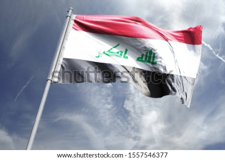 Flag of Iraq in the sky. National Flag of Iraq on flag pole for Independence day.