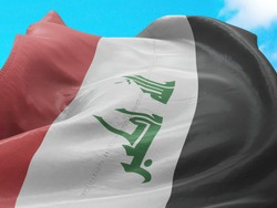 Flag of Iraq on Flag Pole in Blue Sky. Iraq Flag for advertising, celebration, achievement, festival, election. The symbol of the state on wavy cotton fabric.
