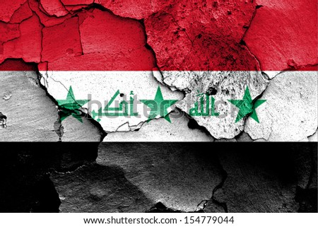 flag of Iraq painted on cracked wall