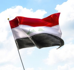 Flag of Iraq Raised Up in The Sky