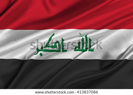 Flag of Iraq waving in the wind.