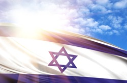 flag of Israel against the blue sky with sun rays