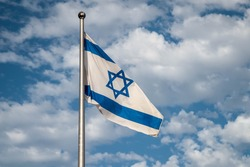 Flag of Israel over the Masada fortress