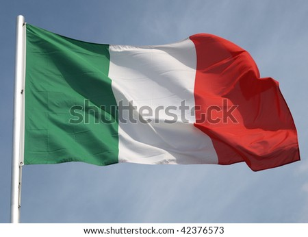 Flag of Italy over a blue sky