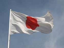 Flag of Japan over a blue sky