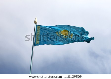 Flag of Kazakhstan on the blue sky background