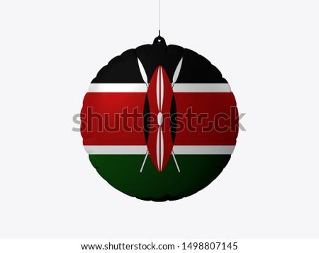 Flag of Kenya on wooden board. Paper Flag of Kenya on wooden table.