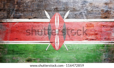 Flag of Kenya painted on grungy wood plank background