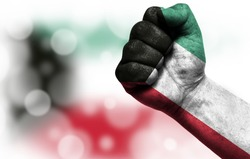 Flag of Kuwait painted on male fist