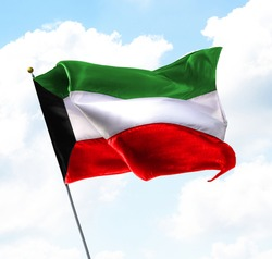 Flag of Kuwait Raised Up in The Sky