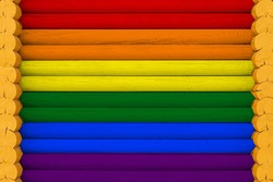 Flag  of LGBT on a wooden wall background. The concept of national pride and a symbol of the country. Flags painted on a house