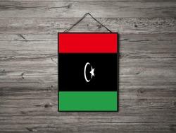 Flag of Libya Hanging on Wall. Libya Flag for advertising, award, achievement, festival, election.