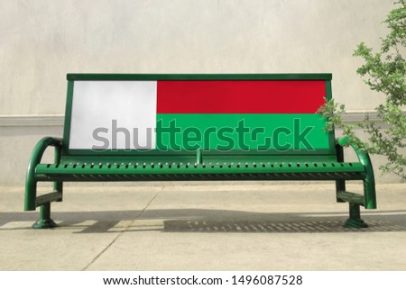 Flag of Madagascar on bench. Madagascar Flag on bench advertisement