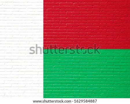 Flag of Madagascar on Bricks Wall. Madagascar Flag for advertising, celebration, achievement, festival, election.