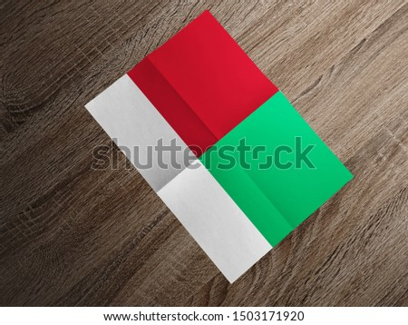 Flag of Madagascar on paper. Madagascar Flag on wooden table.