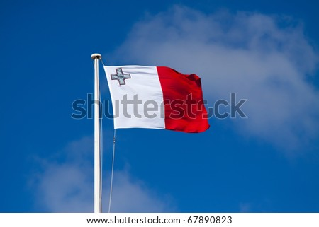 Flag of Malta against blue sky during wind