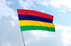 Flag of Mauritius in front of blue sky
