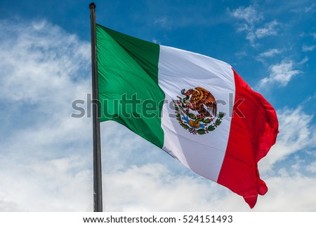 Shutterstock Flag of Mexico over blue cloudy sky