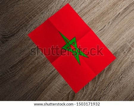 Flag of Morocco on paper. Morocco Flag on wooden table. #1503171932