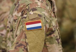 Flag of Netherlands on soldiers arm (collage).