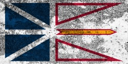 Flag of Newfoundland and Labrador painted on the old grunge rustic iron surface. Abstract paint of Newfoundland and Labrador national flag on the iron surface
