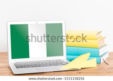 Flag of Nigeria on Laptop. Nigeria Flag on Screen. #1511158256