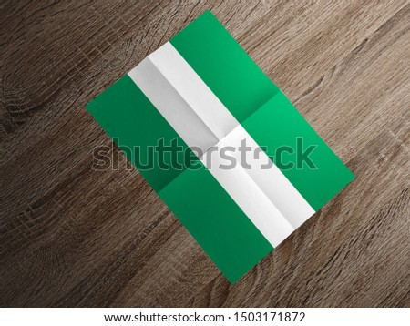 Flag of Nigeria on paper. Nigeria Flag on wooden table. #1503171872