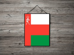 Flag of Oman Hanging on wall. Oman Flag for advertising, award, achievement, festival, election.