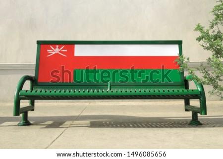Flag of Oman on bench. Oman Flag on bench advertisement