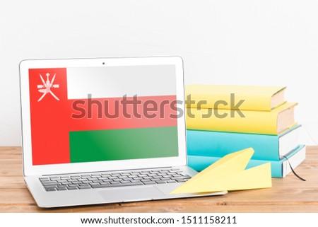 Flag of Oman on Laptop. Oman Flag on Screen.
