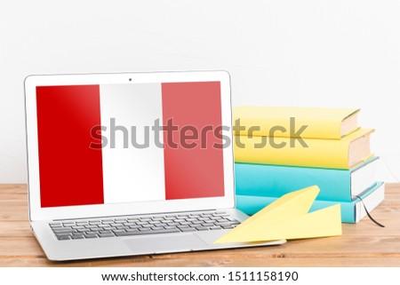 Flag of Peru on Laptop. Peru Flag on Screen. #1511158190