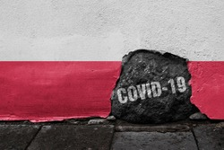 Flag of Poland on the wall with cracked stone with Coronavirus name on it. 2019 - 2020 Novel Coronavirus (2019-nCoV) concept, for an outbreak occurs in the Republic of Poland.