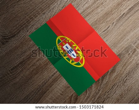 Flag of Portugal on paper. Portugal Flag on wooden table. #1503171824