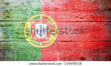 Flag of Portugal painted on grungy wood plank background - stock photo