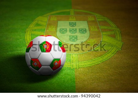 Flag of Portugal with soccer ball over grass background