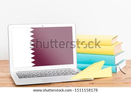 Flag of Qatar on Laptop. Qatar Flag on Screen.
