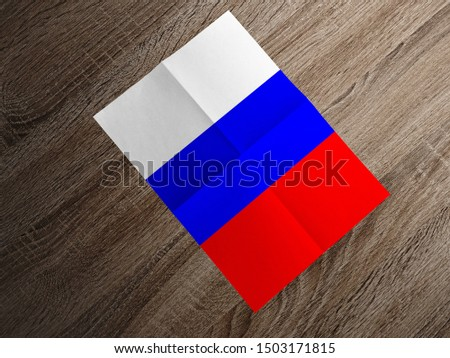 Flag of Russia on paper. Russia Flag on wooden table. #1503171815