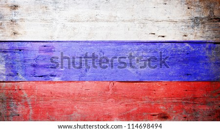 Flag of Russia painted on grungy wood plank background
