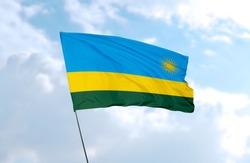 Flag of Rwanda in front of blue sky